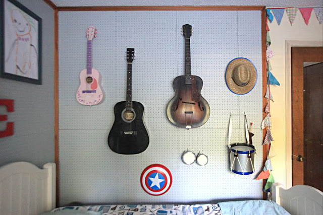 Pegboard Display Wall in a Kids' Shared Bedroom