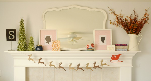 Santa's Sleigh and Reindeer Garland made of paper featured on Remodelaholic.com