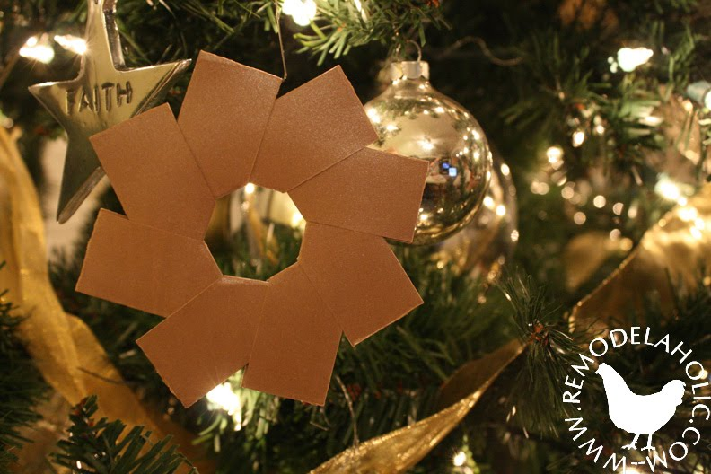 Five Golden Ring Star Ornaments made of paper for an easy Christmas decoration at Remodelaholic.com