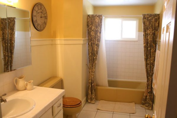 Yellow Tub And Toilet Updated Grey Bathroom