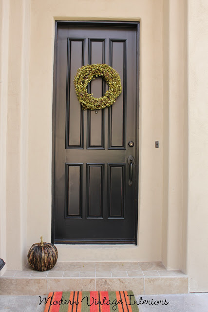 Remodelaholic painting a wooden exterior door black for Black wooden front door