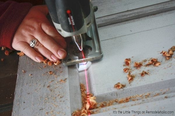 Adding Glass Panels To A Solid Wood Door By Its The Little Things Featured On @Remodelaholic 600x400