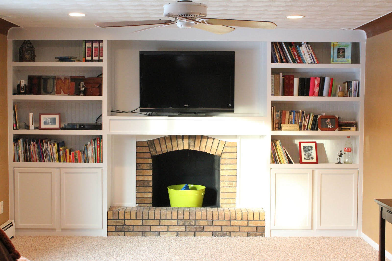This amazing remodel changed the whole look of this living room! A fireplace remodel with built-in bookshelves
