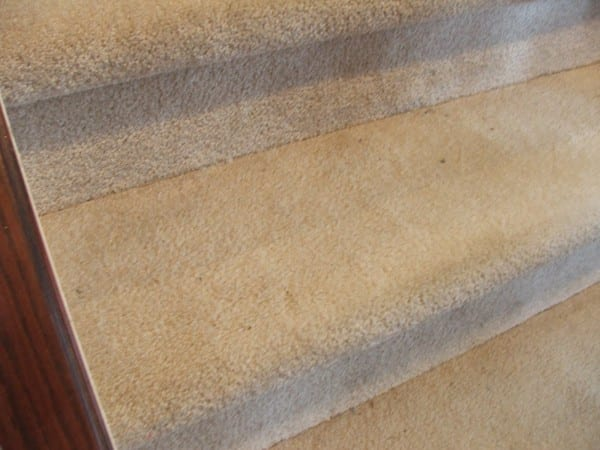 2 Update Your Stairs By Tearing Up The Carpet And Using The Wood Beneath, By Cleverly Inspired, Featured On @Remodelaholic