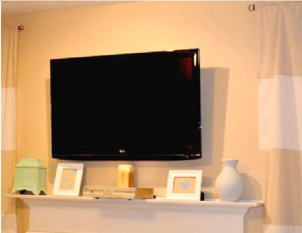 DIY TV Wall Mount For Under 15 Dollars Tutorial Featured On Remodelaholic