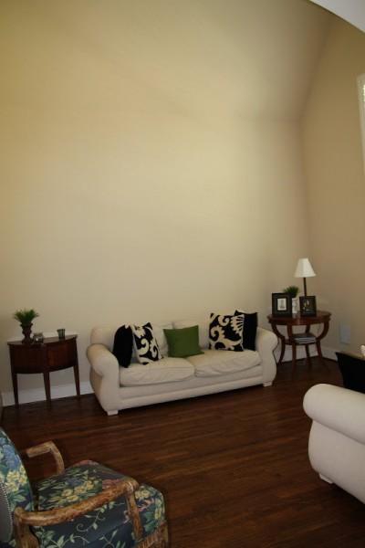 Designing-A-Living-Room-With-Tall-Walls-zebra-pattern-dyed-cow-hide (2)