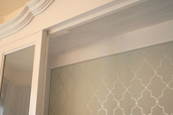 Hutch-makeover-painted-white-stenciled-back-before-and-after