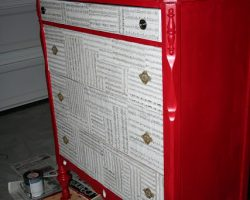 red dresser with music drawer fronts