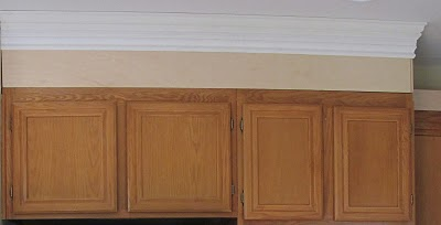 11 Crown molding added to kitchen cabinets, by My Uncommon Slice of Suburbia featured on @Remodelaholic