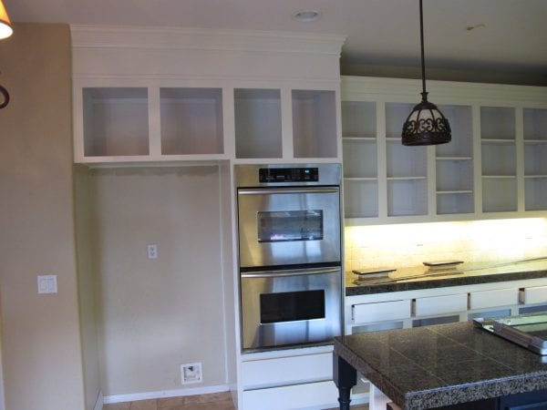 8 Transform a kitchen with DIY staggered cabinets, by My Uncommon Slice of Suburbia featured on @Remodelaholic