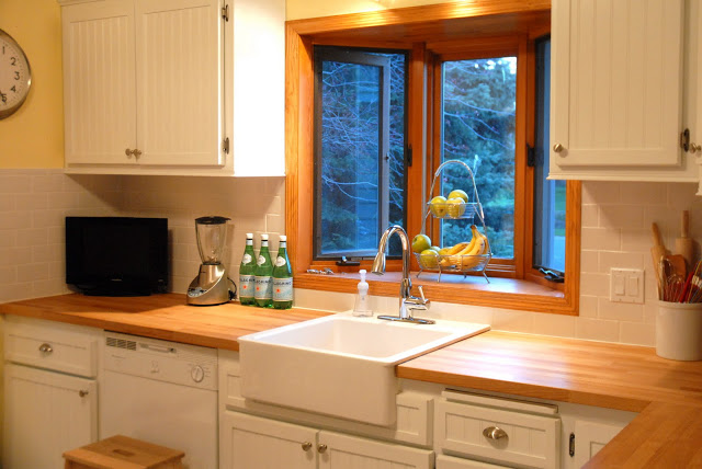 beadboard-kitchen-cabinet-doors-with-butcher-block-counters-subway-tile-backsplash