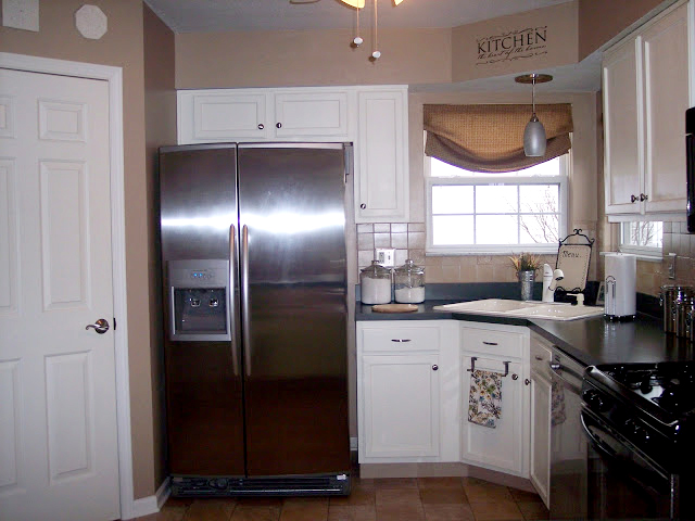 pics of white kitchen cabinets remodelaholic painting kitchen cabinets check 24656