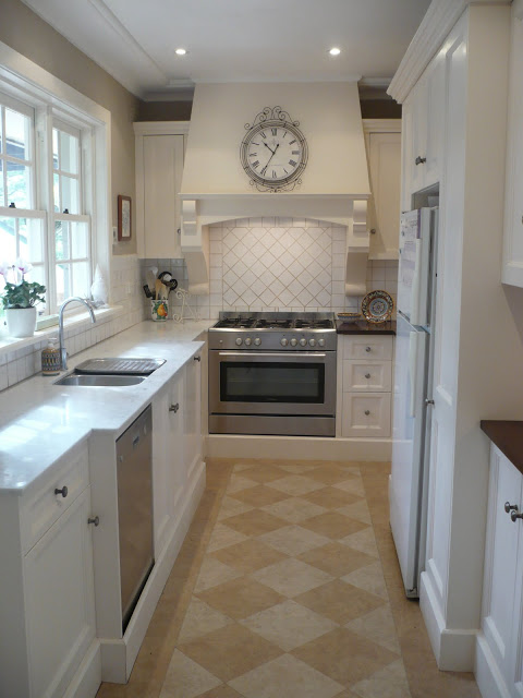 Remodelaholic classically beautiful galley kitchen for Pictures of galley kitchen remodels