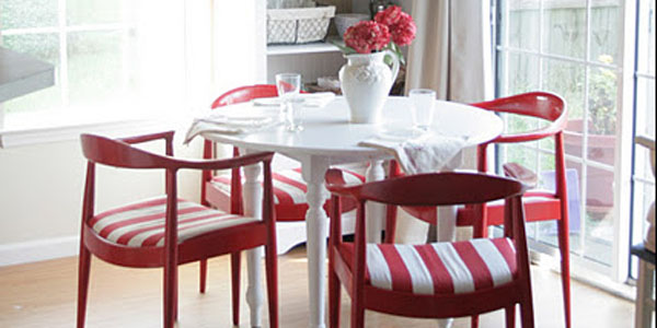 red chairs at white kitchen table