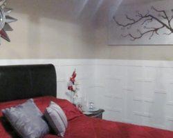 remodelaholic-remodeling-master-bedroom-wainscotting-red (570x280)
