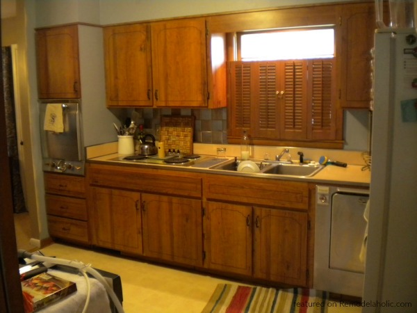 Before Kitchen Renovation, Painted Dark Grey Kitchen Cabinets And Stainless Steel Appliances, Featured On Remodelaholic