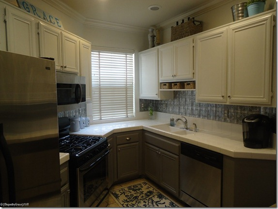two tone painted kitchen cabinets remodelaholic two toned kitchen makeover 8616