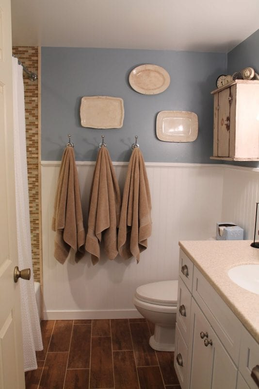 Remodelaholic bathroom renovation with wood grain tile and more for Tiles for small bathrooms pictures