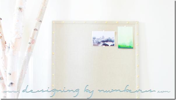 Some photos tacked onto the bulletin board