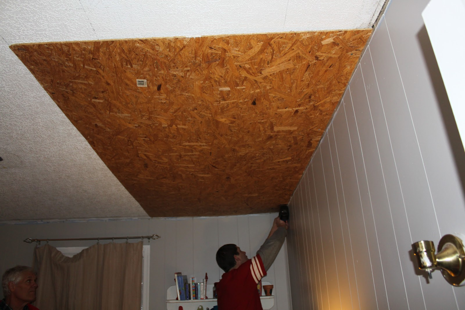 Remodelaholic rustic pallet wood ceiling tutorial for Wooden ceiling cost india