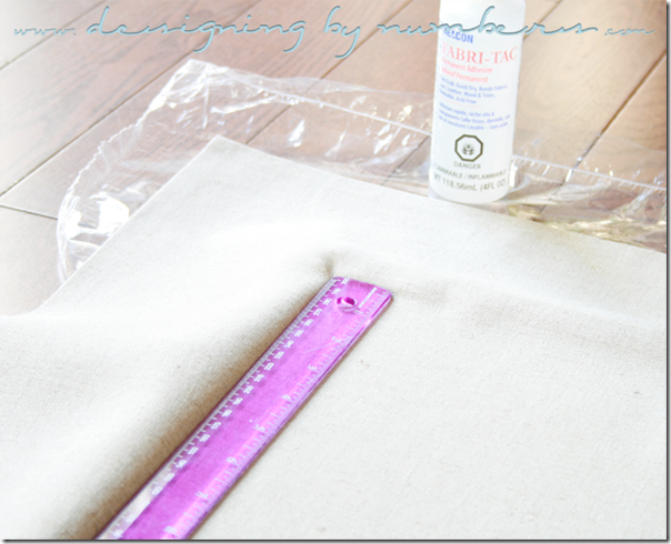 Use a ruler to secure the fabric in the edges