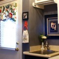redecorated laundry room with chandelier, paint and pictures