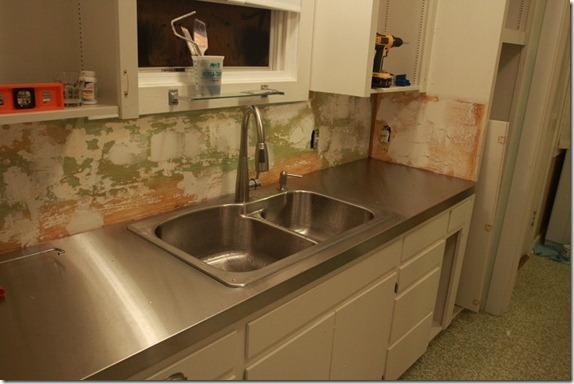 Remodelaholic affordable stainless steel countertops diy for Stainless steel bathroom countertops