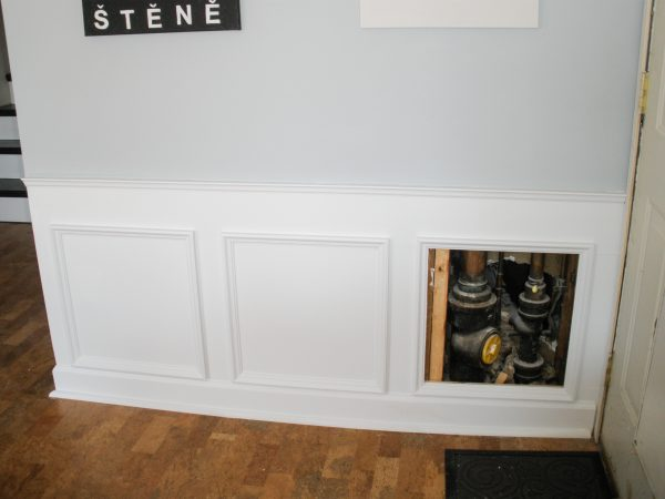 Hiding plumbing access with wainscoting-6