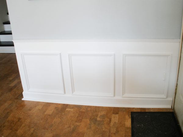Hiding plumbing access with wainscoting-7