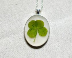 pressed four leaf clover jewelry from Studio Botanica