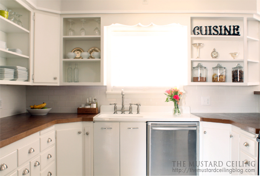finished kitchen with solid wood doors repurposed into countertops the mustard ceiling on