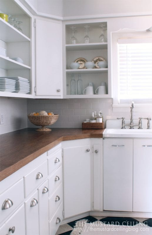 finished white country kitchen with DIY wood countertops from upcycled doors, The Mustard Ceiling on @Remodelaholic