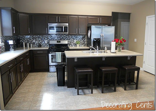 Remodelaholic sleek dark chocolate painted cabinets for Dark brown painted kitchen cabinets