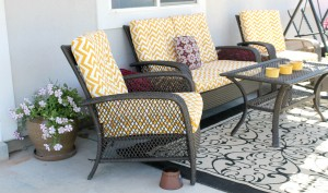 Spectacular Jen of Scissors and Spatulas found an old wicker chair at Goodwill that inspired her porch makeover