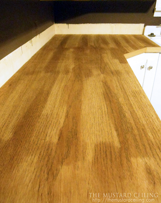 use wood conditioner before staining solid wood upcycled door countertops, The Mustard Ceiling on @Remodelaholic