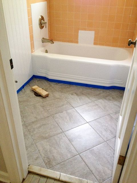 Peel And Stick Laminate Flooring peel and stick vinyl flooring Updating An Old Bathroom With Graoutable Peel And Stick Tiles 6