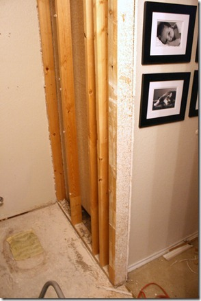 Removing studs to install a pocket door, by Remodelaholic.