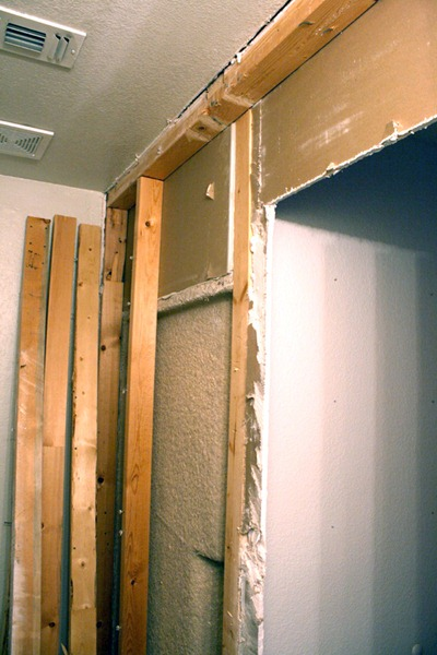 Remove studs but use them again later in a pocket door install. Remodelaholic