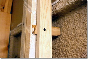 Using shims to ensure a proper fit for a pocket door, by Remodelaholic.