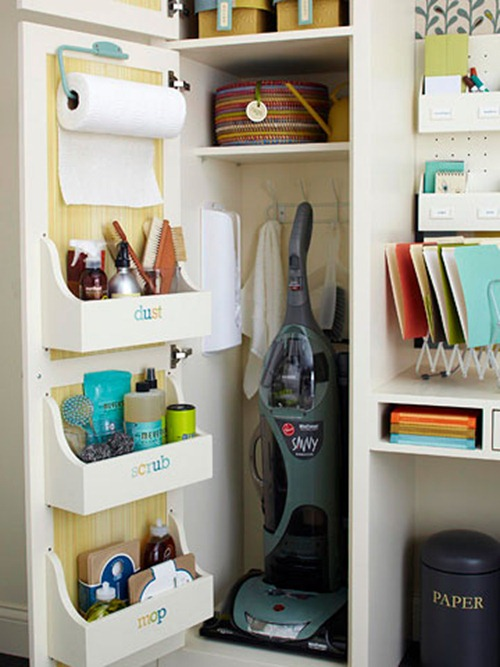 organized cleaning closet with wood cabinet door storage bins