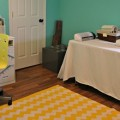 craft-room-chevron-yellow-rug-turquoise-walls-remodelaholic.com-featured image (584x260)