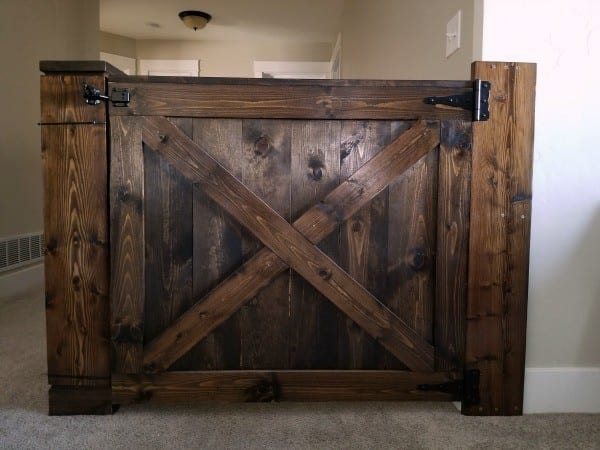 Barn Door Baby Gate Attached To Stair Wall And Banister Without Screws #remodelaholic