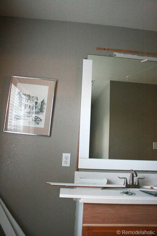 Bathroom Mirror Edge Trim framing a large bathroom mirror | remodelaholic | bloglovin'