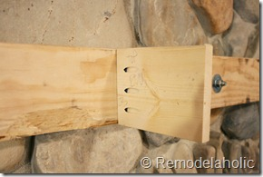Installing a wood mantel on a stone wall (61)