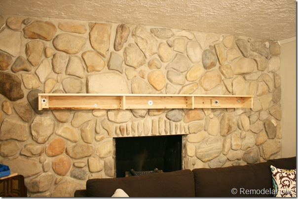 Installing a wood mantel on a stone wall (66)