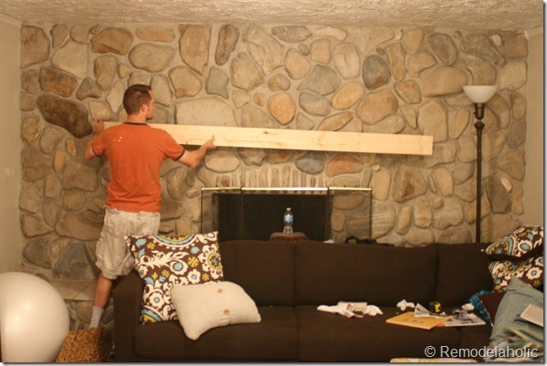 Installing a wood mantel on a stone or brick fireplace wall before