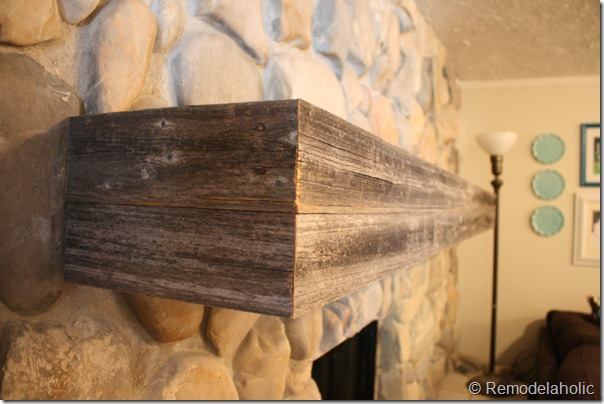 Installing a wood mantel on a stone wall (81)