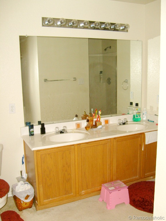 before framing a large bathroom mirror