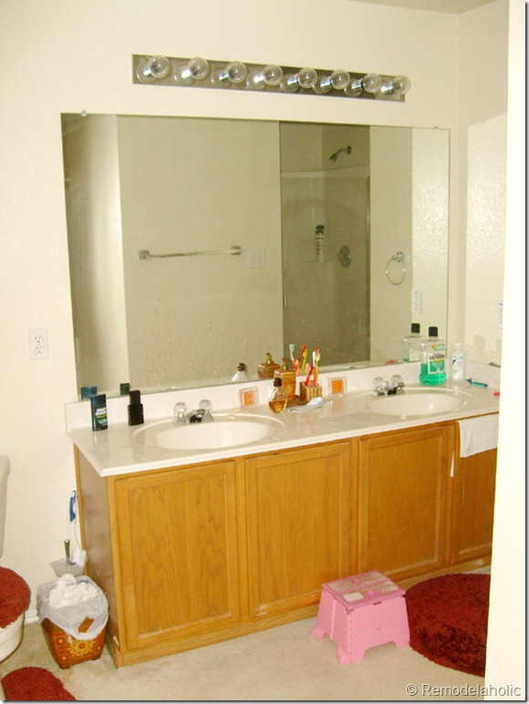 Bathroom Mirror Makeover remodelaholic | framing a large bathroom mirror