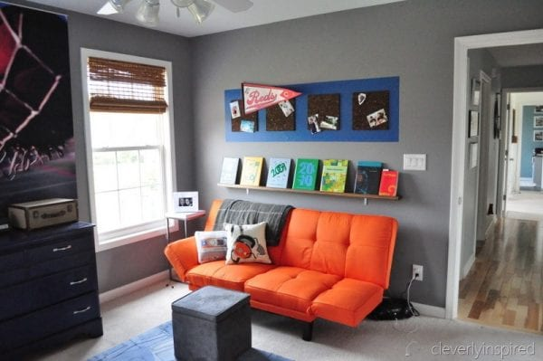 chill zone orange futon for boys room makeover coloful corkboard photo holder, cleverly inspired @remodelaholic